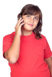 Adorable preteen girl with a mobile. Isolated on white background Royalty Free Stock Image