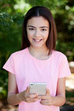 Adorable preteen girl with mobile Stock Photography