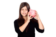 Adorable preteen girl with money box. Adorable preteen girl with moneybox isolated on white background Royalty Free Stock Images