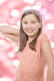 Adorable preteen girl, pink bokeh background Royalty Free Stock Photography