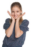 Adorable preteen girl. A portrait of an adorable preteen girl on the white background Royalty Free Stock Images