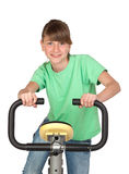 Adorable preteen girl practicing bike. Funny teenage girl practicing bike isolated on white background Stock Photography