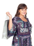 Adorable preteen girl shopping. Isolated on white background Royalty Free Stock Photography