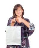 Adorable preteen girl shopping saying OK. Isolated on white background Royalty Free Stock Photos