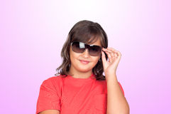 Adorable preteen girl with sunglasses. Isolated on pink background Stock Images