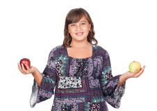Adorable preteen girl with two differents apples. Isolated on white background Stock Image