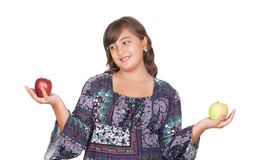 Adorable preteen girl with two differents apples Stock Photos