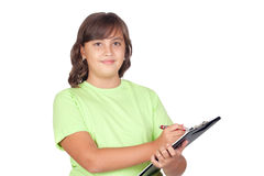 Adorable preteen girl writing on clipboard. Isolated on white background Royalty Free Stock Images