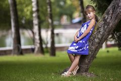 Adorable pretty young child girl with long blond hair in fashion. Adorable pretty young child girl with beautiful long blond hair in fashionable blue dress royalty free stock image