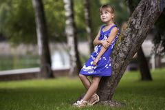 Adorable pretty young child girl with long blond hair in fashion. Adorable pretty young child girl with beautiful long blond hair in fashionable blue dress stock image