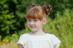 Adorable red-haired girl on green background Stock Images