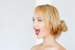 Adorable red-haired woman with opened mouth. Adorable red-haired woman shouts with opened mouth. Impressed carroty girl feeling delight, free space Stock Images