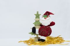 Adorable red Santa Claus with gold and green christmas tree in white background.  Royalty Free Stock Images