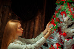 Adorable redhair woman decorate a christmas tree Royalty Free Stock Photography