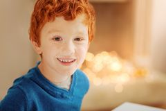 Adorable redhead kid grinning broadly into camera Stock Images