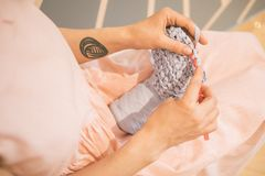 Adorable relaxed knitting hobby. Woman in pink dress. leisure creation of clothes Stock Photo