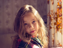 Adorable sad little girl awaked in cold sunny autumn morning Stock Photos