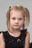 Adorable sad little girl looking at the camera Stock Images