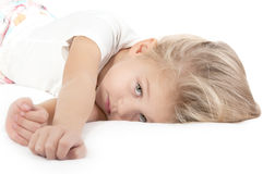 Adorable sad little girl looking at the camera Royalty Free Stock Photography