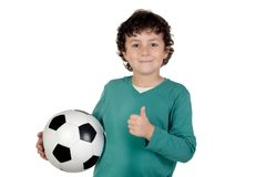 Adorable saying OK with a soccer ball Royalty Free Stock Photos