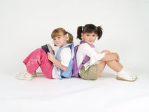 Adorable school girls. Staying back to back Stock Images