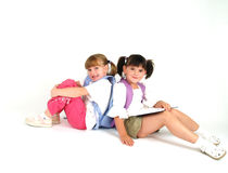 Adorable school girls. Staying back to back Stock Image