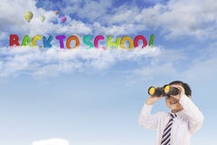 Adorable schoolboy with text of back to school Royalty Free Stock Photography