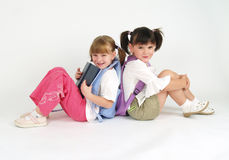 Adorable schoolg girls. On white Stock Images
