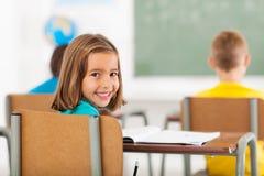 Adorable schoolgirl classroom Stock Photos