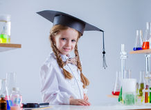 Adorable schoolgirl posing in chemistry class Royalty Free Stock Photos