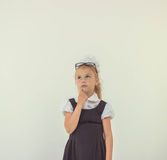 Adorable schoolgirl thinking in uniform Stock Photography