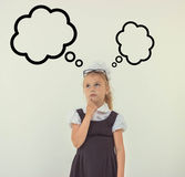 Adorable schoolgirl thinking in uniform Royalty Free Stock Photography