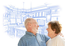 Adorable Senior Couple Over Custom Kitchen Design Drawing on White Stock Photos