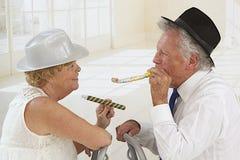 Adorable senior couple partying Stock Photography