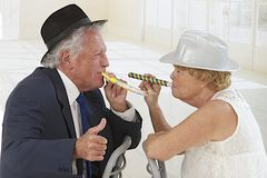 Adorable senior couple partying Royalty Free Stock Images