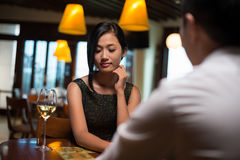 Adorable shyness. Image of a shy yet adorable girl being on a date with her boyfriend Royalty Free Stock Photo