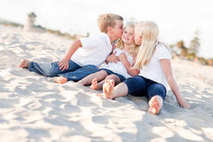Adorable Sibling Children Kissing the Youngest Stock Photos