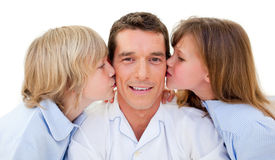 Adorable siblings kissing their father. Against a white background Royalty Free Stock Images