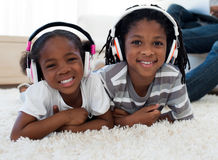 Adorable siblings listening music Royalty Free Stock Photography