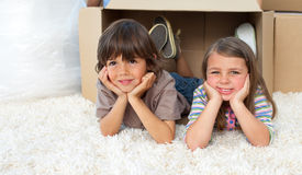 Adorable siblings playing with boxes Stock Image