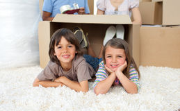 Adorable siblings playing with boxes Royalty Free Stock Photo