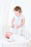 Adorable siblings playing in white nursery Royalty Free Stock Image