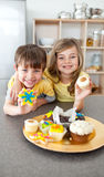 Adorable siblings showing their cookies Royalty Free Stock Photos