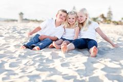 Adorable Sisters and Brother at the Beach Stock Images