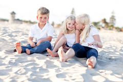 Adorable Sisters and Brother Having Fun at the Beach royalty free stock photo