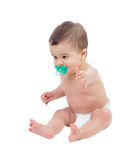 Adorable six month baby in diaper with pacifier Stock Image