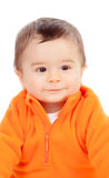 Adorable six month baby with orange jersey Royalty Free Stock Photo