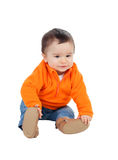 Adorable six month baby with orange jersey Royalty Free Stock Image