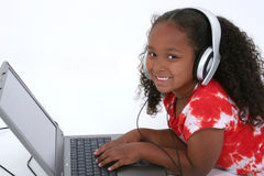 Adorable Six Year Old Girl Sitting On Floor With Laptop Computer Royalty Free Stock Photo