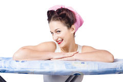 Adorable sixties pin up lady on ironing board Stock Photo